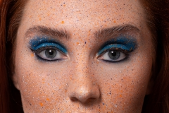 Blue and orange colour splash makeup