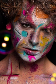 Colourful creative makeup with a sprinkling of glitter and twinkly lights