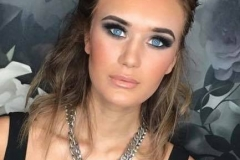 High definition makeup on model Ella with defined eye makeup and nude gloss lips