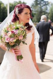 Stunning bride Kim wows with her vintage inspired bridal style.