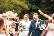Smiles all around - bride Lauren looks simply stunning at her wedding at Whinstone View