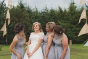 Bride Steph with her bridesmaids having a giggle after the wedding reception at The Lordstone, North Yorkshire.