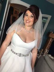 Happy bride Nicola is dressed and ready to set off to her wedding. Her bridal makeup is polished and glamourous.