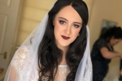 Vintage inspired gown and veil on bride Jo with dark vampy bridal makeup