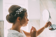 Bride Rachel taking a last glance before setting off for her wedding at Wrays Barn in Great Ayton, North Yorkshire. Makeup by Gemma Rimmington.