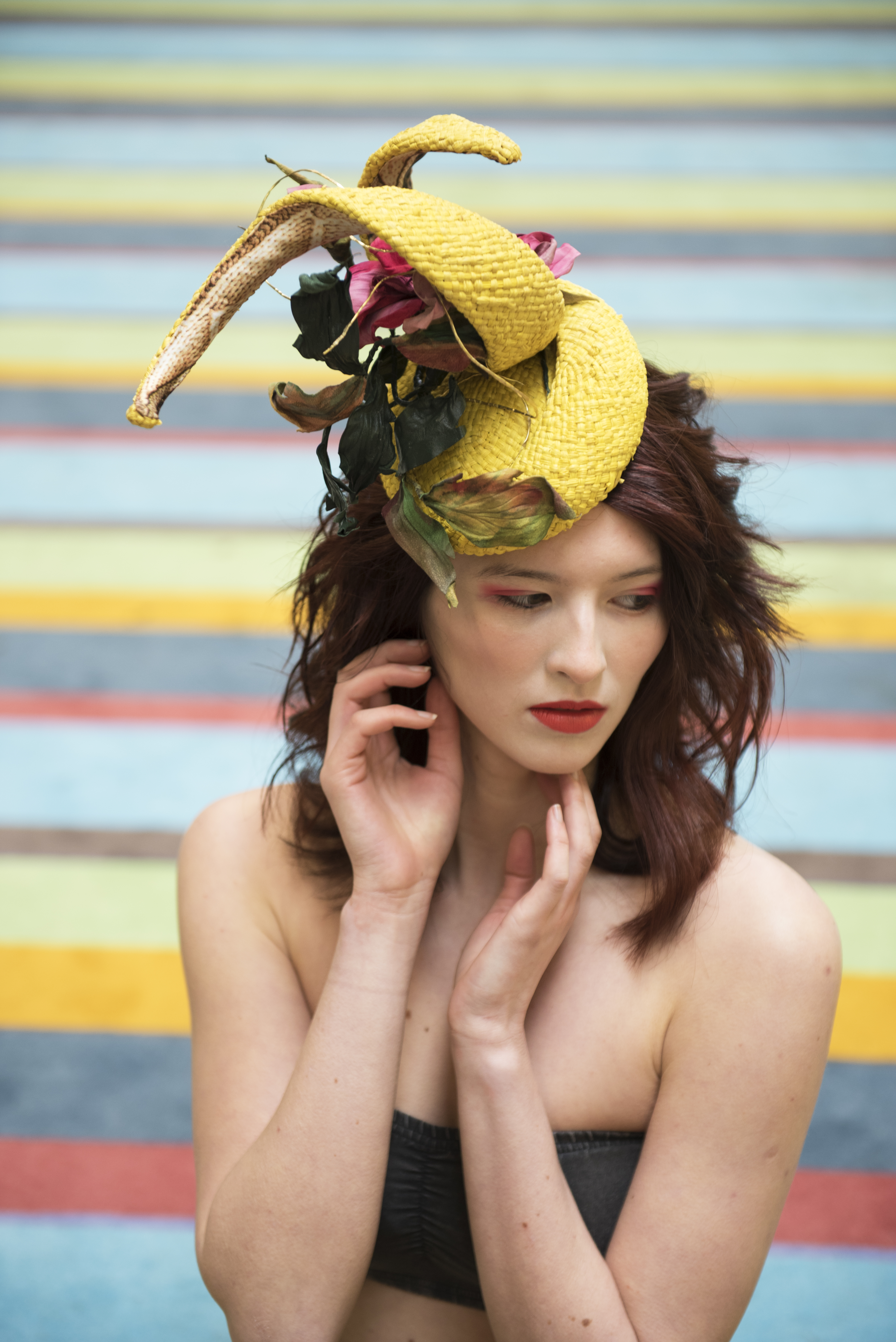 Editorial style makeup, bright orange lips, flawless foundation and a high fashion headpiece.  Photoshoot took place at Tate Modern London