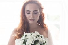 Red head bride with flawless skin and copper eye makeup.