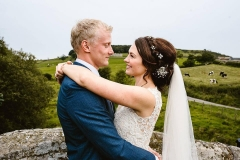 Photo of boho bride Laura and her groom on the moors at Danby, North Yorkshire.