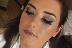 Bride Natalie wears a soft brown eyeshadow, winged eyeliner and a nude gloss.