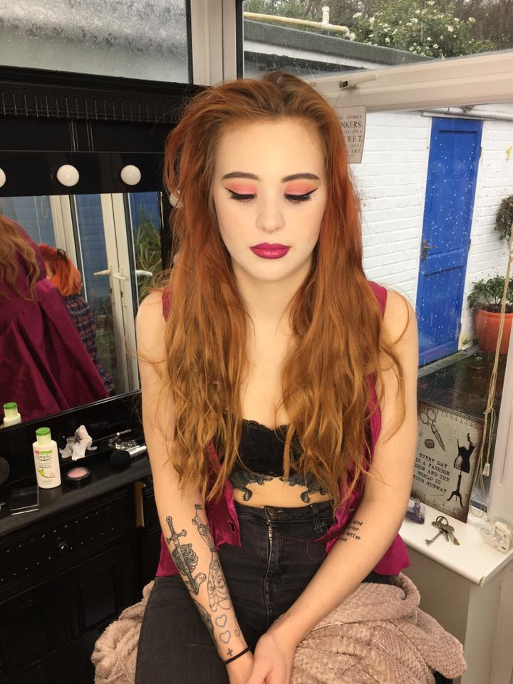 Lottie just finished getting her makeup done in the studio