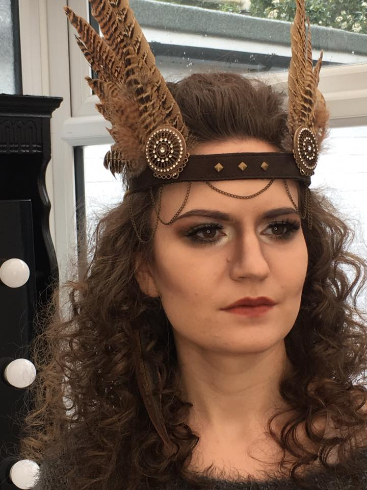 Amy in the makeup studio. Strong makeup to accompany the strong overall look