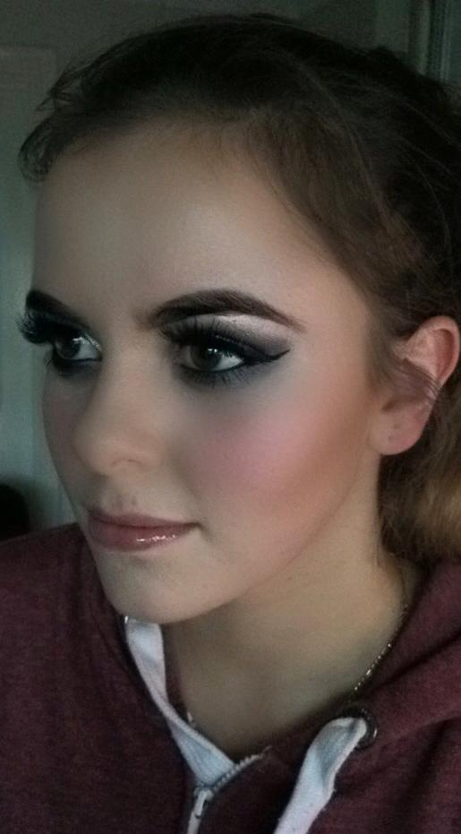 Grace is wearing slate coloured smokey eyes and nude lip
