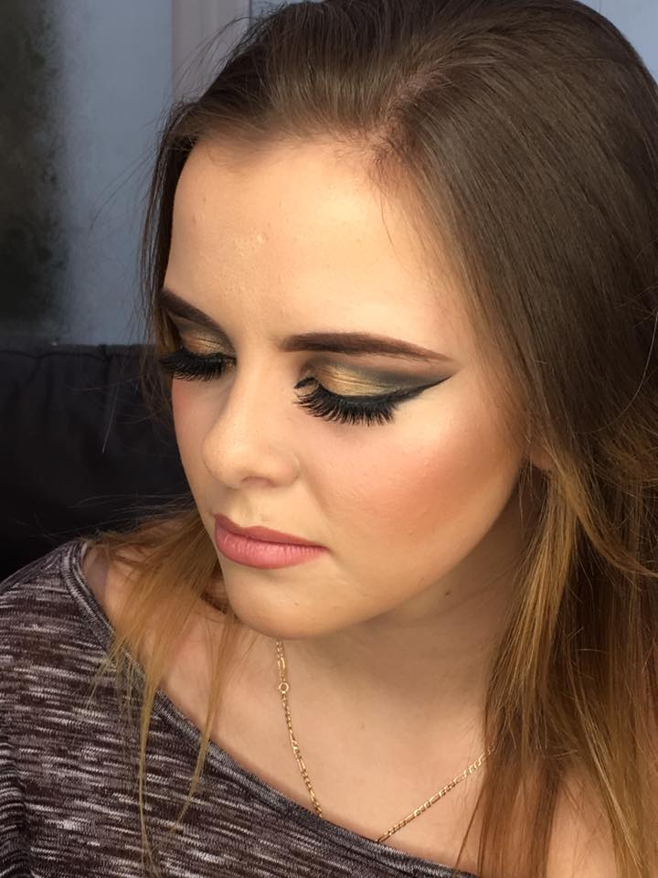 Grace wearing a heavy brown and gold eye winged eye look