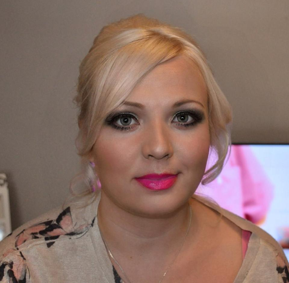 Gemma wears blue smokey eyes and fuscia pink lips for her special occasion