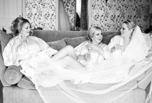Photo of bride and bridesmaids at Grinkle Park near Whitby before her wedding. Makeup done by Gemma Rimmington