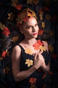 Image taken by Simon Hogben. Model Amy Coulson represents the season Autumn and looks stunning with makeup by Gemma Rimmington - in yellow, orange and red tones.