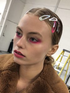 Glossy skin and bright pink neon eye makeup for fashion photoshoot on model Ashley Graves from Milk Model Agency in London.  Makeup by Gemma Rimmington