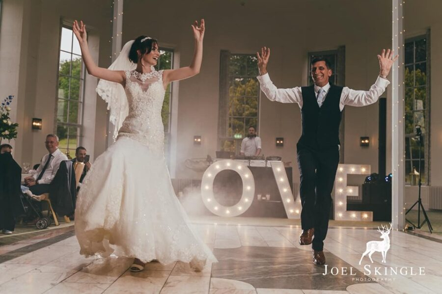 Bride Hannah looks positively happy and glowing dancing with her father