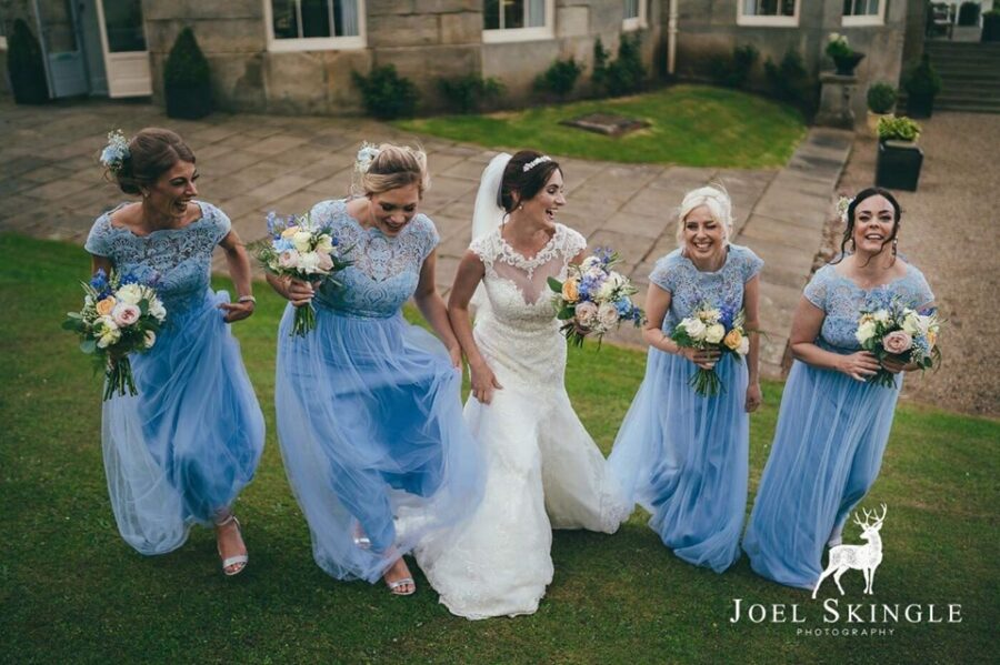 Stunning bridal party with glowing skin and big smiles at Wynyard, Yarm